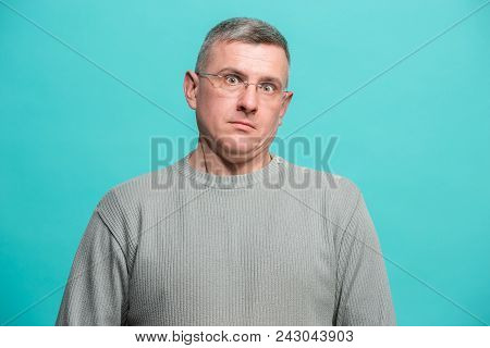 Portrait Of The Scared Man On Blue