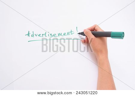 Advertisement. A Female Hand Writing On A White Paper Writes A Hand.