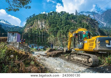 Nepal-march 30, 2018: The Excavator Is Clearing A Construction Site In A Mountain Village On March 3