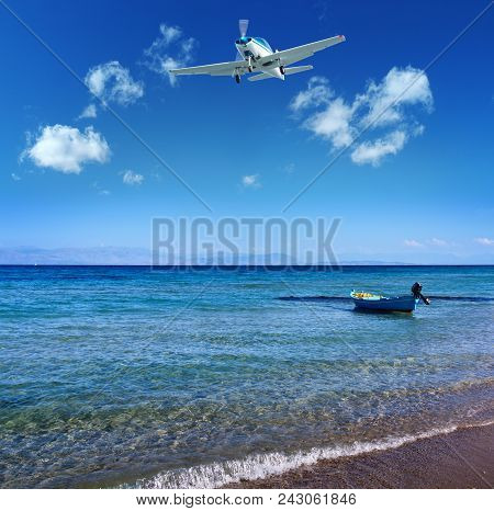Small Boat Near The Shore On The Mediterranean Sea - Small Plane Flying By