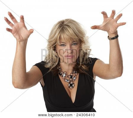 Waist up view of woman in a bad mood on white background.