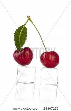 sweet cherry with ice cube on white