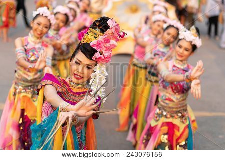 BANGKOK, THAILAND, JANUARY 17, 2018 : Group of women dancers dressed in traditional clothes during a dance show at the Thailand tourism festival in the Lumphini park, Bangkok, Thailand