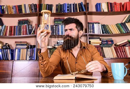 Man On Busy Face Reading Book, Bookshelves On Background. Lesson And Time Concept. Scientist With Ey