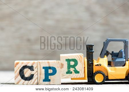 Toy Forklift Hold Letter Block R In Word Cpr (abbreviation Of Cardiopulmonary Resuscitation) On Wood