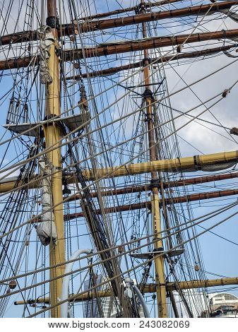 Masts, Ropes And High Tackles Of A Tall Ship Or Barque. Image Shows The Complexity Of The Sail Raisi