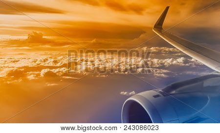 Wing Of An Airliner Plane In Flight. Blue Sky. A Wing Of A Passenger Jet Airbus. During The Flight.