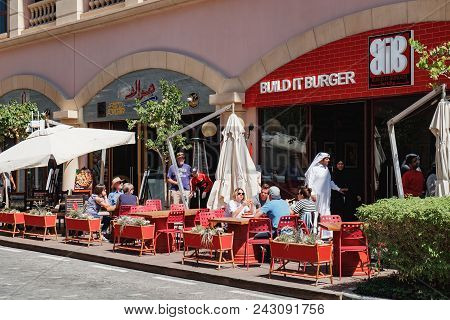 Doha, Qatar - March 3, 2018: Build It Burger - Street Cafe With People In The Central District Of Th