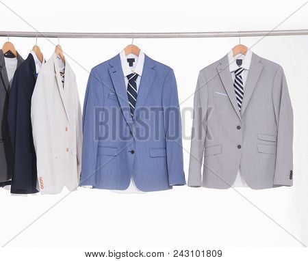 Set of Suits with shirts on hangers