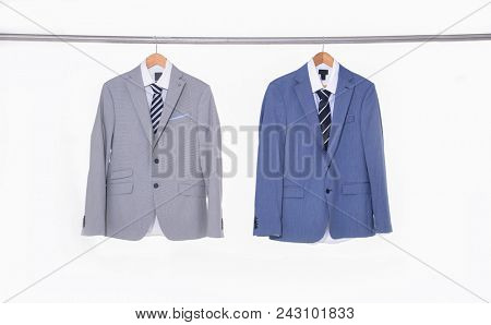 Two Suits with shirts on hangers
