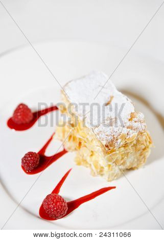 Piece Of Mille-feuille Cake On Porcelain Plate