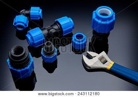 Set Plumbing And Tools On A Green Background.