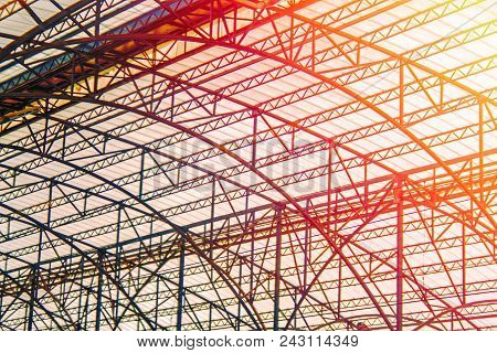Railway Station Steel Srame Structure With Space Frame Roof. Curved Roof In The Warm Orange Rays Of