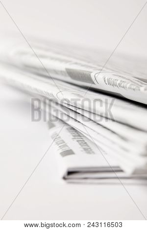 Close Up Of Pile Of Daily Newspapers, Selective Focus On White