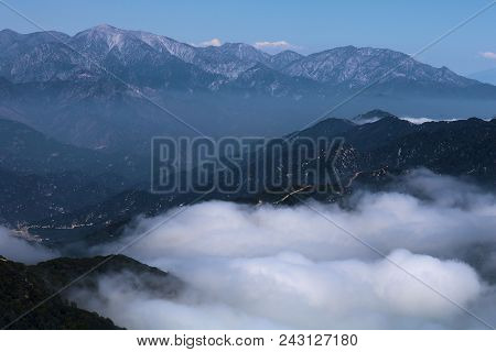 Low Laying Clouds And Fog Surrounding Mountain Ridges Taken In The San Gabriel Mountains, Ca