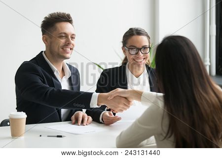 Smiling Hr Manager And Hired Female Applicant Won Job Interview Shaking Hands, Friendly Executive Ha