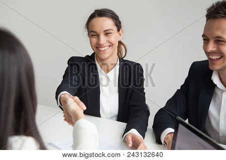 Smiling Female Hr Handshaking Employee Welcoming Hired Worker, New Team Member, Cheerful Positive Bu