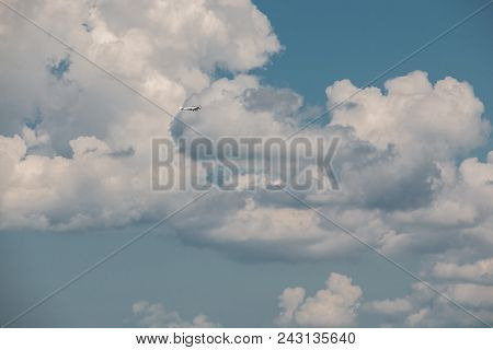 Little Plane Approaching Into The Blue Germany Sky With White Clouds