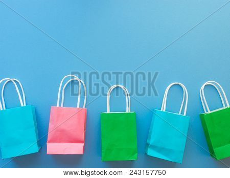 Colorful Shopping Paper Bags On Blue Background With Copy Space/summer Shopping Concept