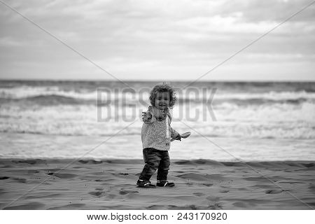 Childhood. Cute Fair-haired Kid Tiny Little Child Baby Boy In Jeans Striped Shirt And Tie Running Ab