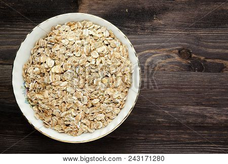 Oatmeal On A Wooden Table. Oatmeal Top View. Healthy Food .
