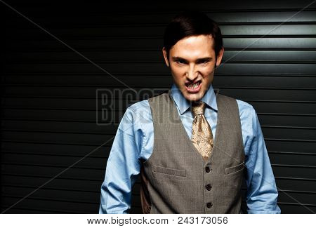 Fashionable Well Dressed Man Isolated On Black