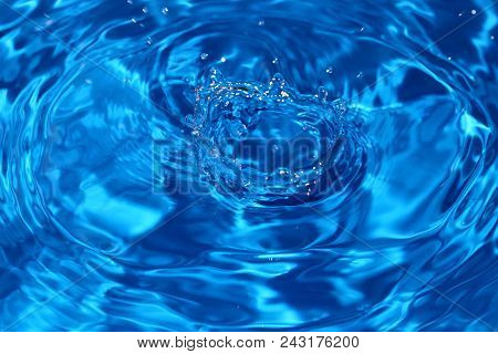 Water Dripping Or Water Ripples In A Pond. Waves Of Rippling Water.