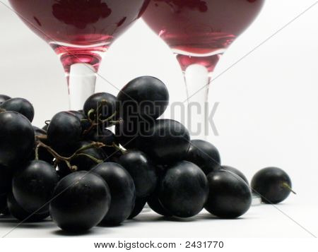 Two Wineglasses And Grapes