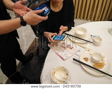 Zhongshan,china-may 13, 2018:doing Payment At A Restaurant Via Wechat Money On Mobile.wechat Or Alip