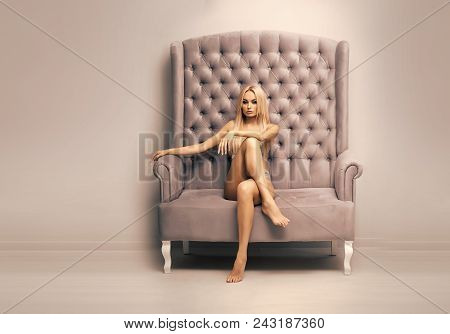 Sexy Woman. Fashion Model In Sexi Underwear. Woman In Sexy Lingerie Sit On Sofa, Fashion. Sensual Wo