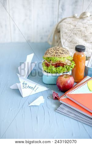 Sandwich For School Lunch And Juice, Healthy Lunch. School Books On The Table. Copy Space.