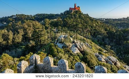 Rear View Of The Impressive Red Side Of Palace Da Pena On Top Of The Hill With Forest And Castle, Si