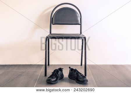 Take Action Or Quick. The Concept Of Creative Search For Ideas And Quick Action. Black Chair In A Ro