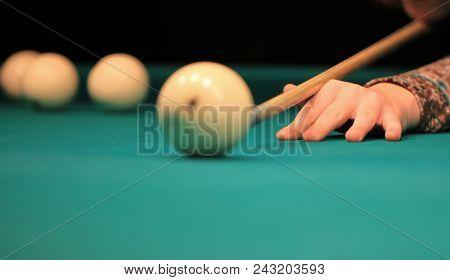 Playing Billiard. Billiards Balls And Cue On Green Billiards Table. Billiard Sport Concept. Pool Bil