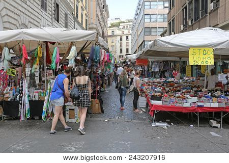 Rome, Italy - June 30, 2014: Flea Market Stalls With Cheap Shoes And Clothing In Rome, Italy.