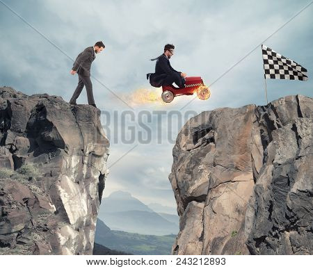 Fast businessman with a car wins against the competitors. Concept of business success and competition poster