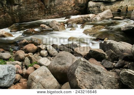 A River With Small Waterfalls Flowing Through A Rocky Canyon.  Adirondack Park, Ny, Usa.