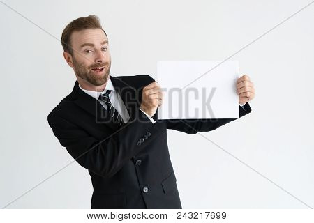 Cheerful Young Businessman Presenting New Information, Offer, Service. Positive Caucasian Man In Jac