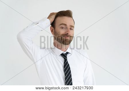Grinning Conceited Businessman Self Satisfied. Young Man In Tie And White Shirt Touching Hair With V