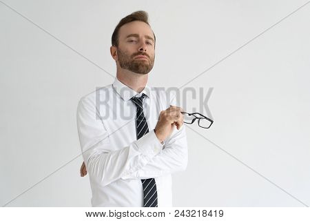 Young Arrogant Business Expert Posing For Camera. Vain Serious Caucasian Man With Pained Face Expres