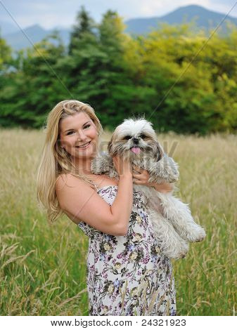 Beautiful Female With Cute Little Dog Friend Outdoors