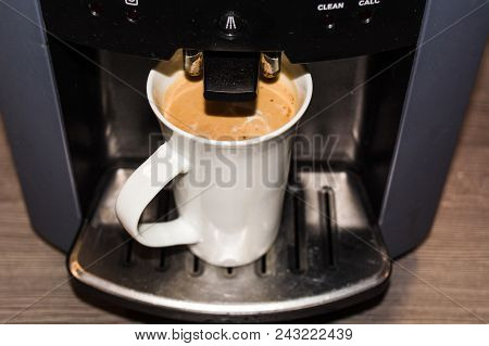 Office Coffee Machine, Professional Machine With A Cup Full Of Coffee According To Slat Type.