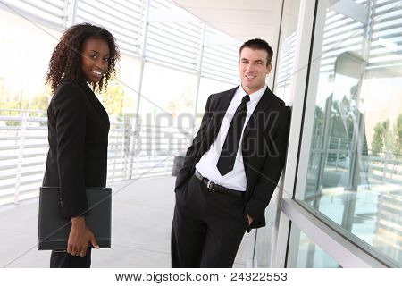 An ethnic diverse man and woman business team at office building