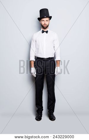 Full Size Fullbody Portrait Of Stylish Attractive Magician In Tophat, Formal Wear, Bow, Looking At C