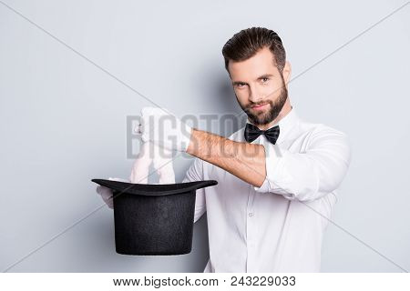 Portrait Of Attractive Stylish Entertainer With Bristle, Stubble, Hairstyle, Having Tophat In Arms A