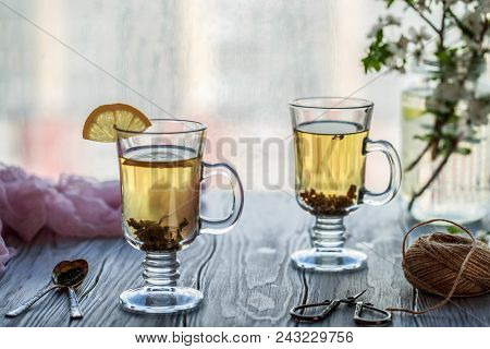 Fresh Green Tea. Tea Cup With Green Tea Leaf On The Wooden Table. Tea With Lemon