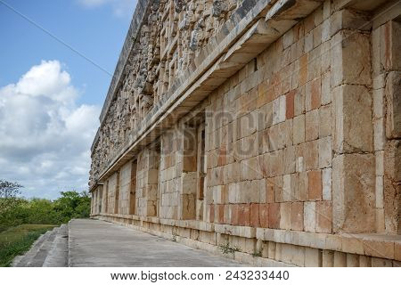The Wall Of The Palace Of The Ruler In The Ancient City Of Maya Uxmal. Mexico
