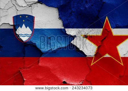 Flags Of Slovenia And Yugoslavia On A Wall