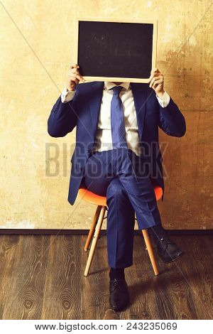 Promotion. Businessman Holding A Blackboard, Promotion. Businessman Holding A Blackboard