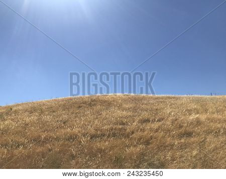 A Simple Blue Sky Background Over A Hill